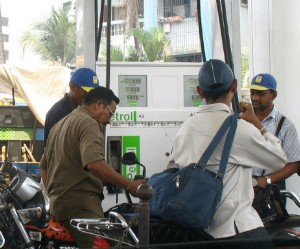 men at petrol pump