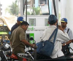 men at petrol pump