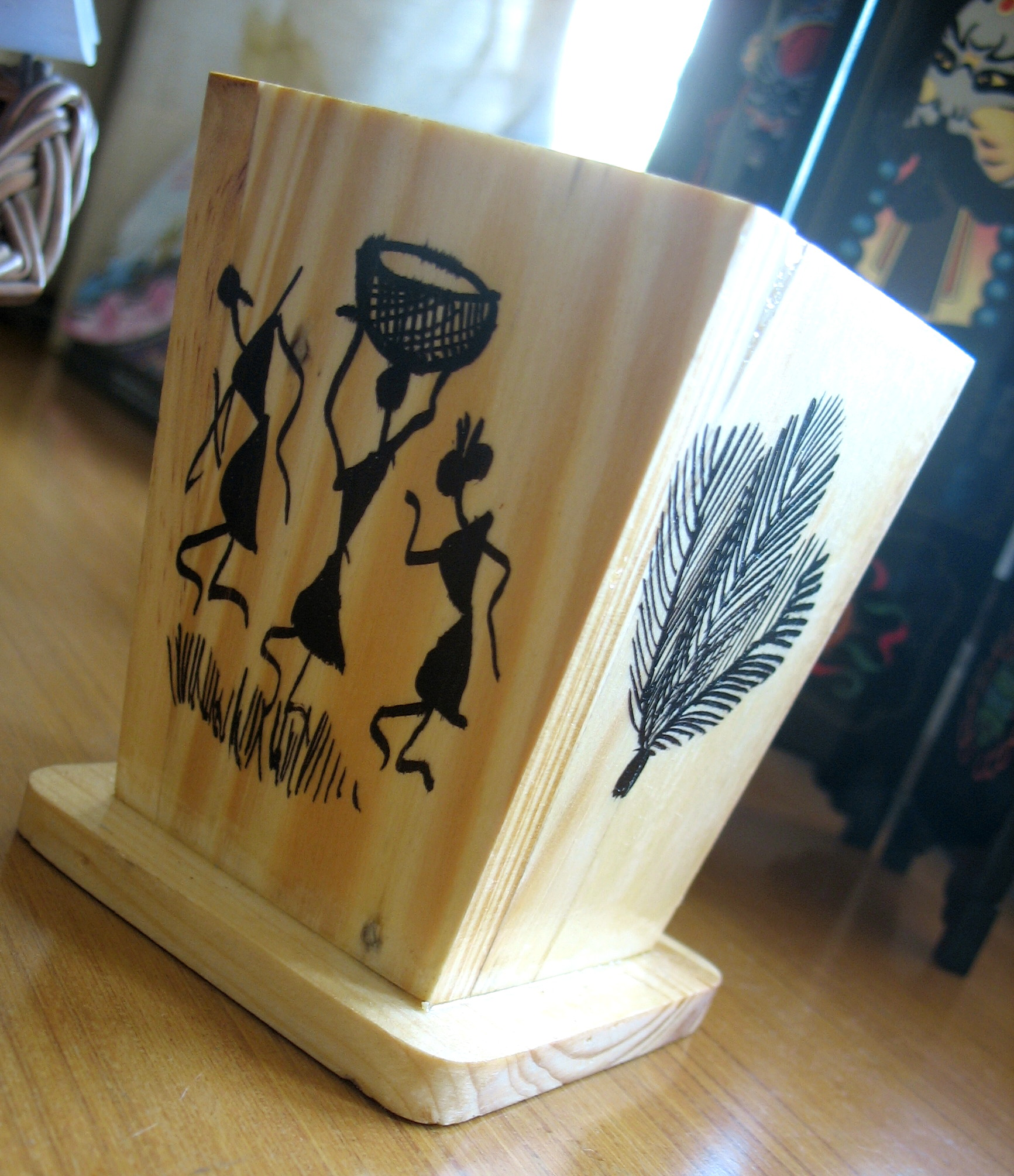 wooden pen-stand with warli drawings